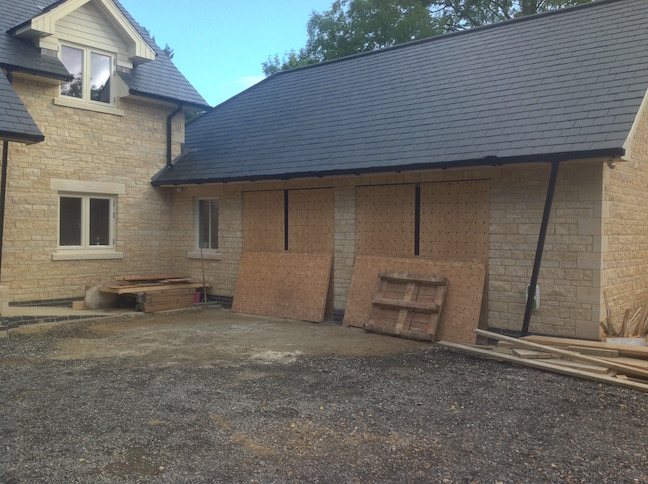 Stone Property ready for garage doors