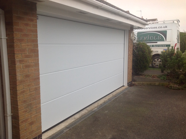 Hormann L-Ribbed Sectional door in White Sandgrain finish by LGDS Ltd