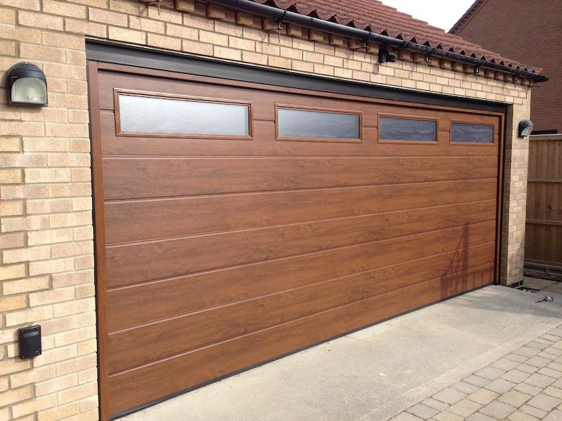 Hormann Sectional door in Dark oak by LGDS Ltd