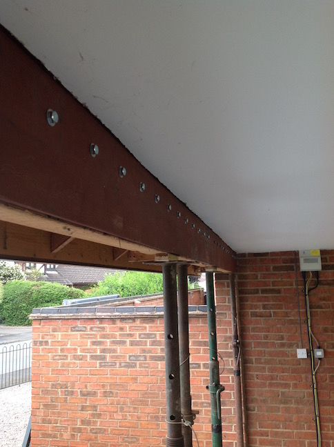 Steel plate installed to reinforce existing wooden beam