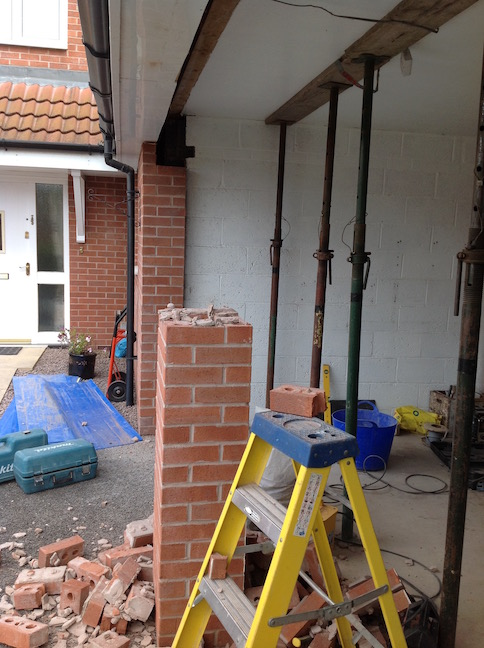 Roof supported and centre pillar & lintels removed