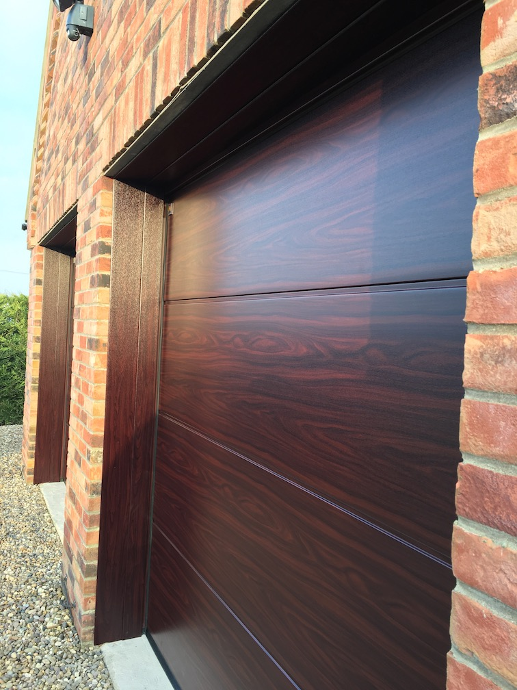 2 Hörmann sectional doors in Decograin Rosewood