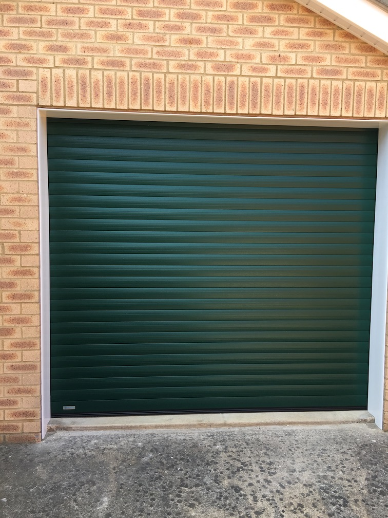 SeceuroGlide Excel roller shutter in Green wood grain