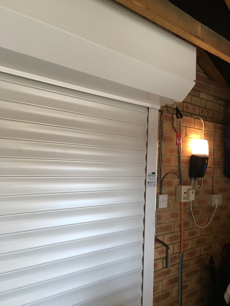 SeceuroGlide Excel roller shutter in Green wood grain inside view