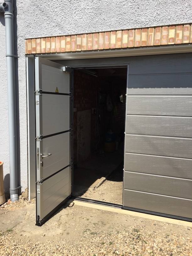 Hörmann sectional door including wicket door