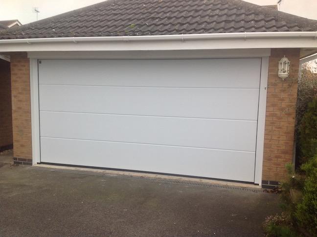 Hormann L-Ribbed Sectional door in White Sandgrain finish by LGDS Ltd
