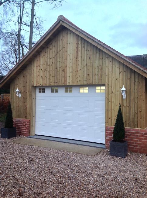 Hormann Sectional door in White Woodgrain S- Panelled design by LGDS