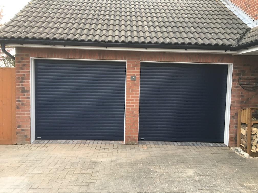 2 Seceuroglide Classic Roller shutter doors in Blue Woodgrain