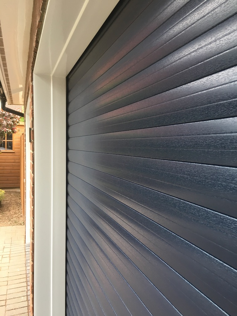 Blue woodgrain Roller shutters close up view