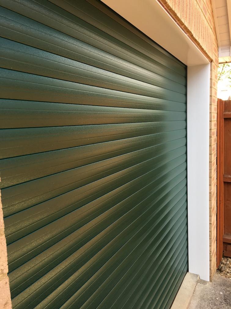 SeceuroGlide Excel roller shutter in Green wood grain