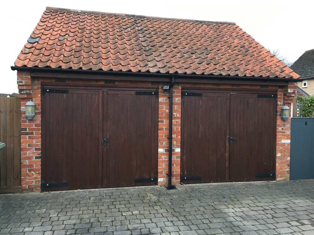 2 Old side hinged timber doors