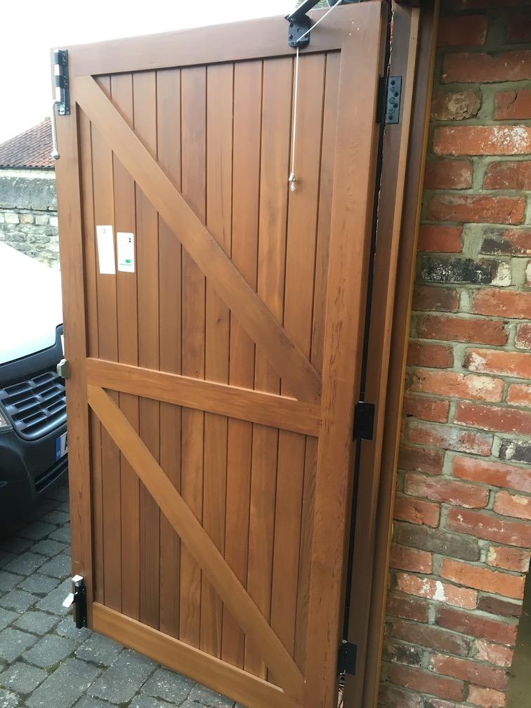 door leafs open showing door stays and security shoot bolts