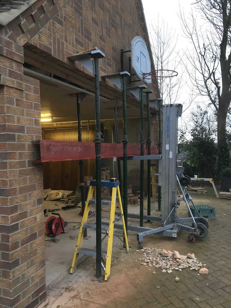 Bricks removed from the front and new steel offered into position