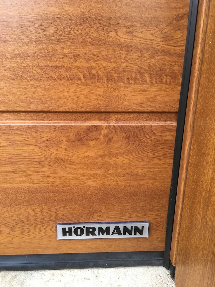 A Hörmann M-ribbed sectional door in Golden Oak
